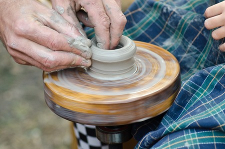 potters wheel: potter the manufacture pitcher on the potters wheel