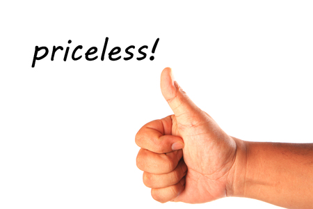 priceless: Hand with one thumb up with word priceless isolated on white.