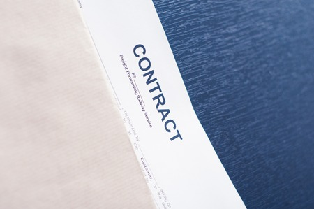 Contract in a brown envelope on a black table photo