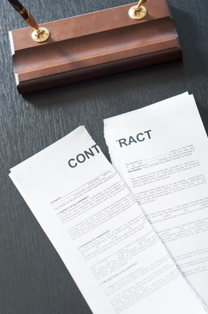 Terminate the contract on a black table with a pen