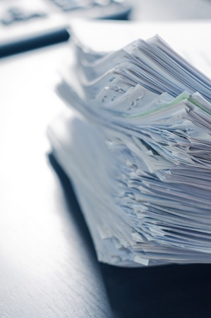 printed matter: Stacks of paper on the office table.