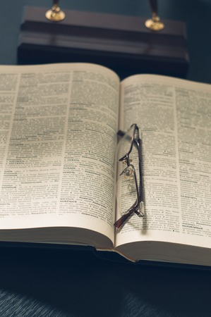 cramming: picture of a pile of books and eyeglasses, with a retro effect. Stock Photo