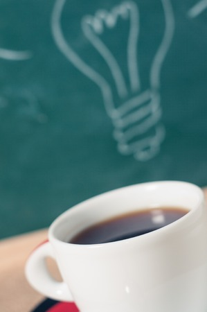 coffee cup and business idea on wooden table.