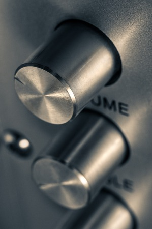 turn dial: Detail of sound volume controls in vintage style.
