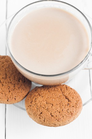 oatmeal cookie: oatmeal cookie with coffee wooden white background.