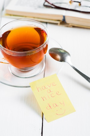 happyness: have a nice day with smile and cup tea.