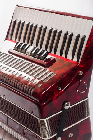 overtone: red musical instrument accordion