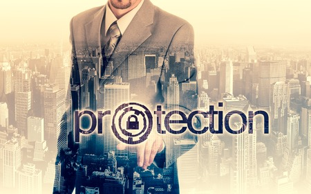 cyber defence: technology and internet concept - businessman pressing protection button on virtual screens. Stock Photo