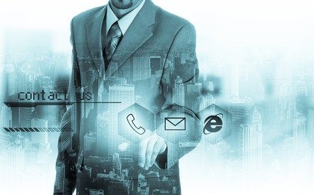 contact icons: Businessman pressing virtual phone buttons. customer support concept. Stock Photo
