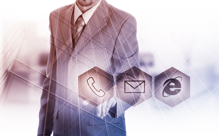 Businessman pressing virtual phone buttons. customer support concept. Reklamní fotografie