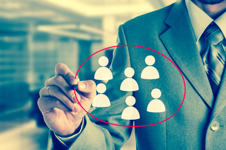 Hand pointing to businessman icon - HR, recruitment and chosen concept.