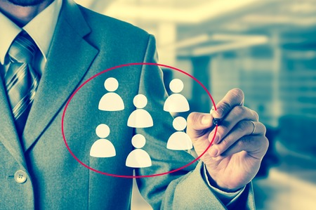 chosen: Hand pointing to businessman icon - HR, recruitment and chosen concept.