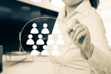 Hand pointing to businesswoman icon - HR, recruitment and chosen concept.