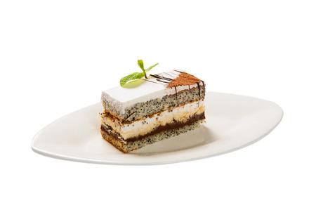 poppy leaf: Cake with poppy seed and leaf fresh mint. Stock Photo