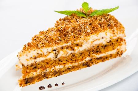 honey cake: Honey cake plate with fresh mint leaf.