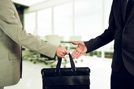 handover: business transfer. handover of a suitcase in the hands of partners.