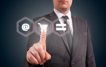selecting: Online shopping business concept selecting shopping cart. Stock Photo