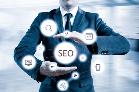optimisation: Businessman suggested effective SEO optimisation approach. Hands presenting a SEO flowchart. Stock Photo