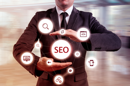 suggested: Businessman suggested effective SEO optimisation approach. Hands presenting a SEO flowchart. Stock Photo