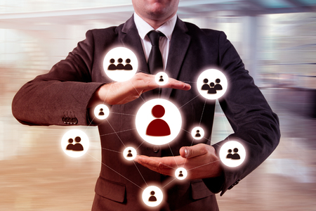 multi level: Hand carrying businessman icon network - HR,HRM,MLM, teamwork and leadership concept.