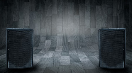 loud speaker: Large black speakers on wooden background with space for text writing.