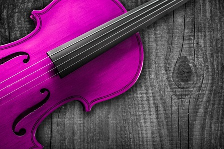 solo violinist: Pink Violin on grey wooden background. With space for text writing