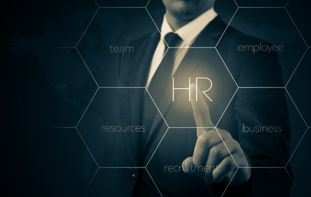 Hand pointing to businessman icon-HR, recruitment and chosen concept. Stock Photo