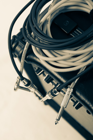 amp: Close-up of guitar amplifier with jack cable. Stock Photo