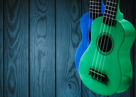 bluegrass: Part of an acoustic guitar on a blue wooden background
