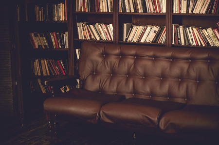 living room sofa: Retro living room with brown leather sofa.