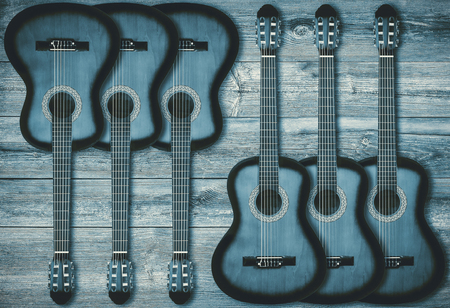 bluegrass: Part of a blue acoustic guitar on a wooden background Stock Photo