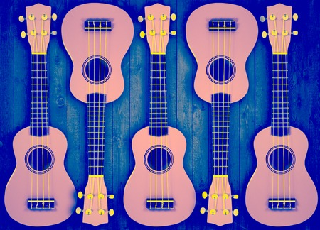 bluegrass: Part of a blue acoustic guitar on a gray wooden background