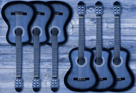 Part of a blue acoustic guitar on a wooden background Stock Photo