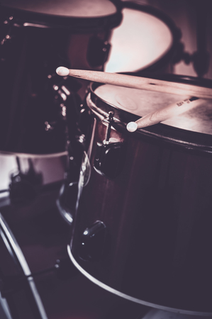 snare: Drums conceptual image. Picture of drums and drumsticks lying on snare drum Stock Photo