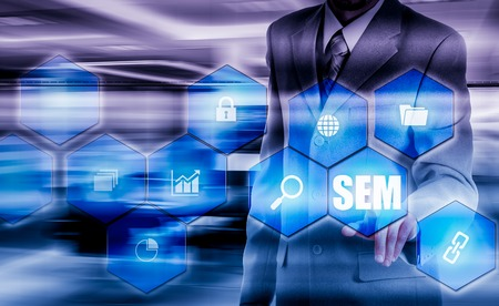 SEM-Search Engine Marketing. Business Strategy Concept. The businessman shakes his finger on a virtual screen