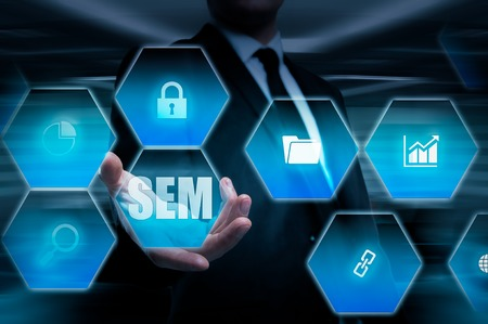 page rank: SEM-Search Engine Marketing. Business Strategy Concept. The businessman shakes his finger on a virtual screen