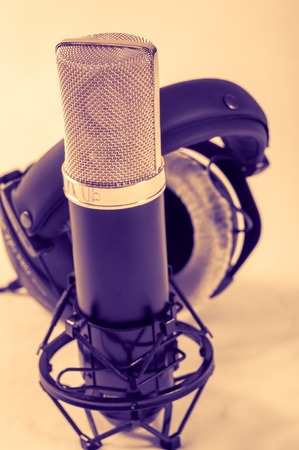 Microphone in a recording studio on a white background Stock Photo