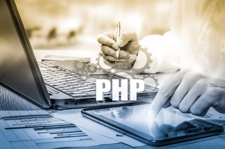 press button: technology and internet concept - businessman holds the php button on virtual screens. Stock Photo