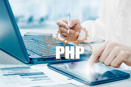 technology and internet concept - businessman holds the php button on virtual screens. Stock Photo