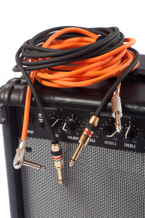 Close-up of guitar amplifier with jack cable