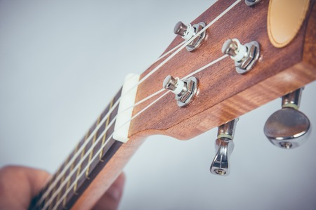 music background: Part of an acoustic guitar on a grey background