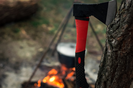 outdoor fireplace: Hiking pot in the bonfire. Traveling in the mountains with tents.
