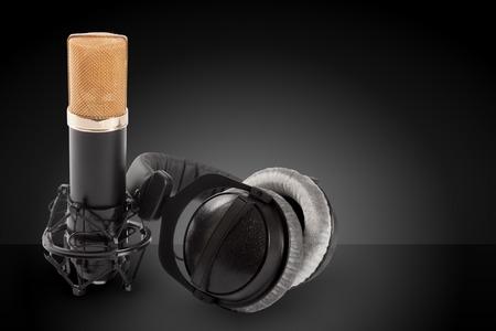 cardioid: Headphones and condenser microphone on the dark background Foto de archivo