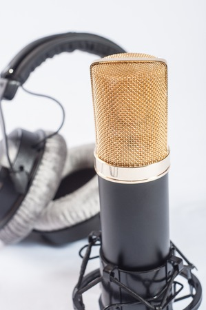 Headphones and condenser microphone isolated on the white background
