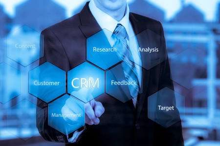 Customer relationship management concept man selecting CRM. Stock Photo