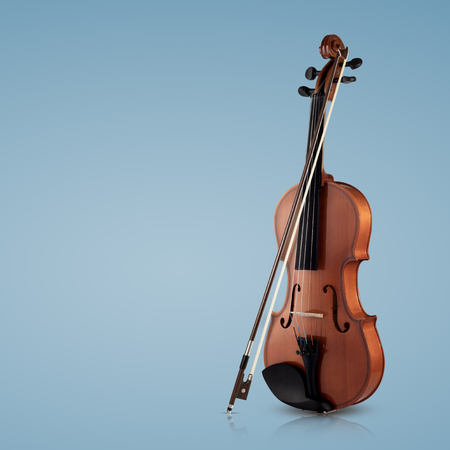 Violin musical instruments of orchestra closeup on blue background 写真素材