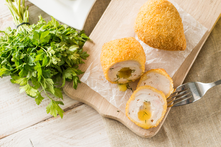 Chicken Kiev cutlets with parsley leaves and butter