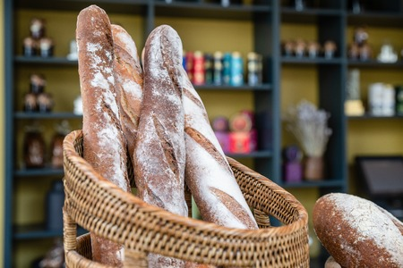 Freshly made bread in bakery. Whole grain organic loaf beautiful delicious french style baguette handmade golden brown.
