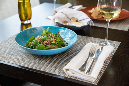 Fresh vegetable salad on wooden background.
