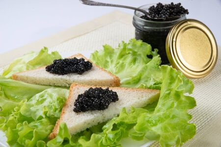 Sandwiches with black caviar